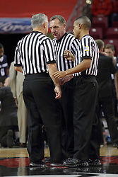 16 November 2014:  Referee meet at half court - Randy McCall (back to camera), David Hall (center) and Verne Harris during an NCAA non-conference game between the Utah State Aggies and the Illinois State Redbirds.  The Aggies win the competition 60-55 at Redbird Arena in Normal Illinois.