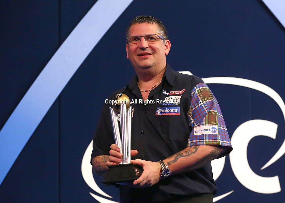 02.01.2017. Alexandra Palace, London, England. William Hill PDC World Darts Championship final  between top seeds Michael van Gerwen (1) and Gary Anderson (2). Former World Champion Gary Anderson holds his Runners up Trophy, after losing to Michael van Gerwen by 7 sets to 3