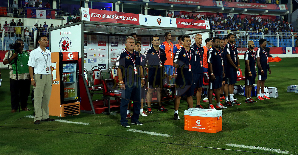 FC Goa team stand in dugout for national anthem during match 9 of the Indian Super League (ISL) season 2  between FC Goa and Chennaiyin FC held at the Jawaharlal Nehru Stadium, Fatorda, Goa, India on the 11th October 2015.<br /> <br /> Photo by Sandeep Shetty / ISL/ SPORTZPICS