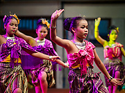19 NOVEMBER 2018 - BANGKOK, THAILAND: A traditional Thai dance troupe from a local school performs during the Loy Krathong Fair along Klong (Canal) Ong Ang in Bangkok. This the first public event along the canal. Businesses that line the canal weve evicted about two years and the walkways along the canal were renovated. Loy Krathong takes place on the evening of the full moon of the 12th month in the traditional Thai lunar calendar. In the western calendar this usually falls in November. Loy means 'to float', while krathong refers to the usually lotus-shaped container which floats on the water. Traditional krathongs are made of the layers of the trunk of a banana tree or a spider lily plant. Now, many people use krathongs of baked bread which disintegrate in the water and feed the fish. A krathong is decorated with elaborately folded banana leaves, incense sticks, and a candle. A small coin is sometimes included as an offering to the river spirits. On the night of the full moon, Thais launch their krathong on a river, canal or a pond, making a wish as they do so. The krathongs made at the Klong Ong Ang fair were made out of bread so they would decompose and feed the fish in the canal. Loy Krathong will be celebrated on November 22 this year.    PHOTO BY JACK KURTZ