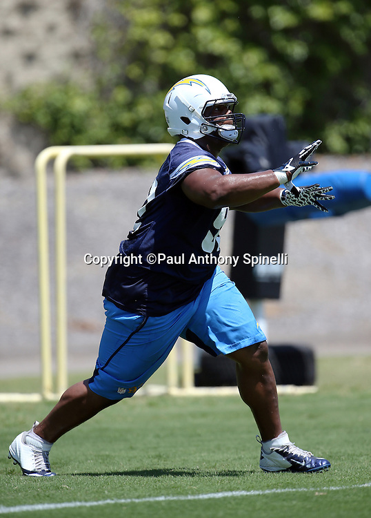 San Diego Chargers nose tackle Ryan Carrethers (92) catches a pass during the San Diego Chargers Spring 2015 NFL minicamp practice held on Tuesday, June 16, 2015 in San Diego. (©Paul Anthony Spinelli)