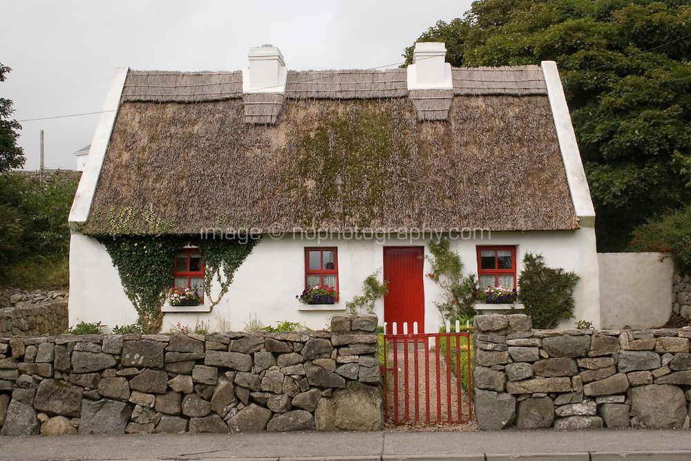 Traditional thatched cottage in Spiddle Village County Galway Ireland