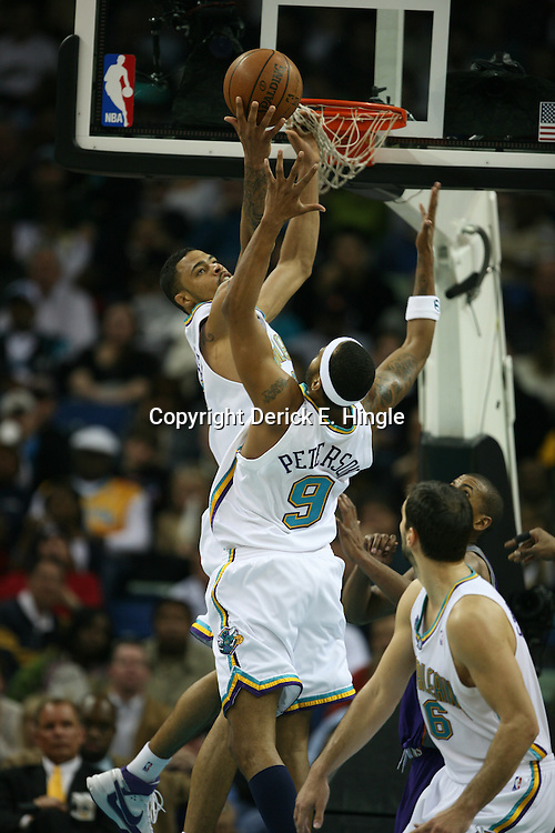 Tyson Chandler #6 grabs a rebound in front of teammate Morris Peterson #9 for the New Orleans Hornets against the Phoenix Suns on February 26, 2008 at the New Orleans Arena in New Orleans, Louisiana. The New Orleans Hornets defeated the Phoenix Suns 120-103.