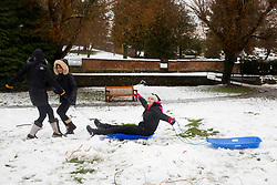 © Licensed to London News Pictures. 11/12/2017. Amersham, UK. Girls play in the snow in Amersham. Yesterday parts of the south east of England experienced heavy snow, with the home counties experiencing some of the worst conditions. Many schools in the area are closed today. Photo credit : Tom Nicholson/LNP