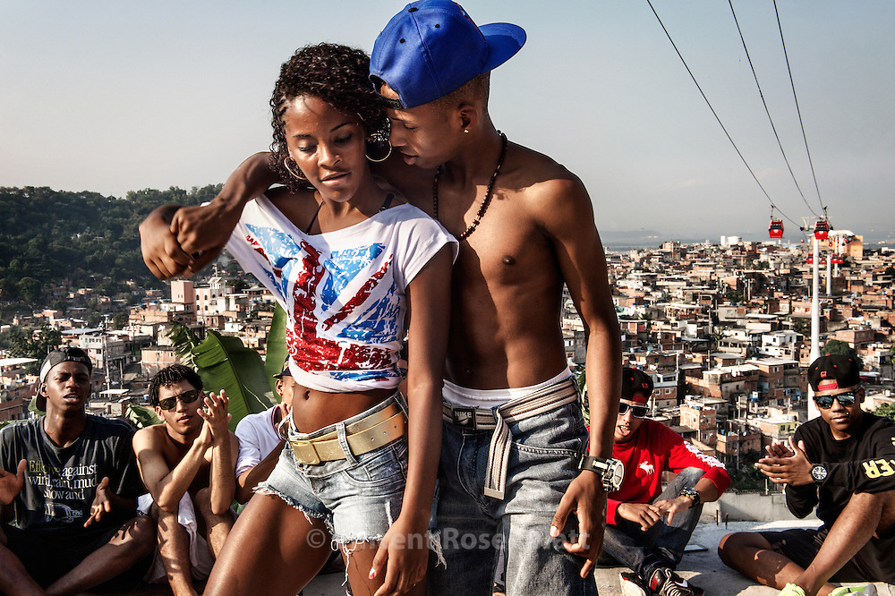"Marcelly ""Miss Passista"" and Ronald ""Sheick"" duo. Rehearsal of the show ""Na Batalha"" on a rooftop of the Complexo do Alemão favelas. Elite dancers of the ""Passinho"" (little step) the newest dance fever that came out the Baile Funk culture. Marcelly is from the favela Morro dos Macacos & Ronald from the Complexo da Maré."