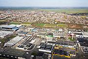 Nederland, Utrecht, Harmelen, 04-03-2008; bedrijventerrein, stadsuitbreiding richting Woerden: aantasting van het Groene Hart, dit is zichtbaar aan de horizon en daar nog niet bebouwd; verschimmeling, verrommeling. .luchtfoto (toeslag); aerial photo (additional fee required); .foto Siebe Swart / photo Siebe Swart