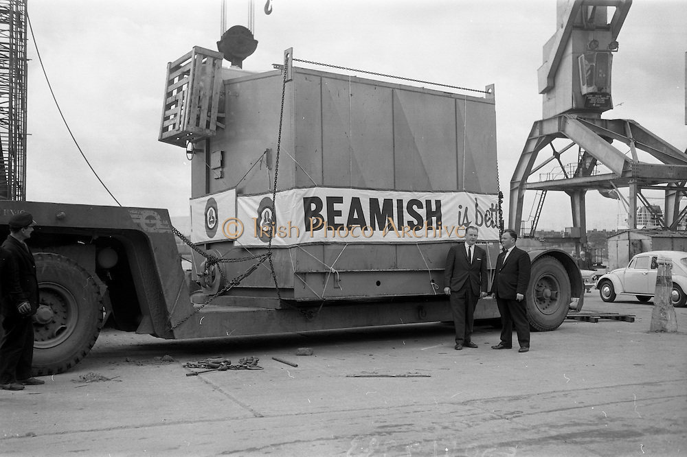 08/05/1965<br /> 05/08/1965<br /> 08 May 1965<br /> New Beamish and Crawford Boiler Arrives. A new 22 ton boiler for the Beamish and Crawford brewery arrived from Canada on Saturday at Dublin Port and was transported by road to the Cork brewery, where further extensions were planned. Picture shows Mr Frank Cassidy, Sales Administration Manager, Beamish and Crawford viewing the unloading of the boiler by the 100 ton crane at Dublin docks.
