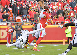 Dec 30, 2018; Kansas City, MO, USA; Kansas City Chiefs quarterback Patrick Mahomes (15) throws a pass as Oakland Raiders defensive end Arden Key (99) pressures during the first half at Arrowhead Stadium. Mandatory Credit: Denny Medley-USA TODAY Sports