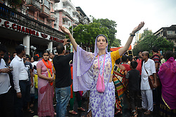 June 25, 2017 - Kolkata, India - Foreign devotees sing and dance during the annual Rath Yatra, or chariot festival. Devotees pull chariots with idols of Hindu god  Jagannath, Balabhadra and Subhadra through the streets of Kolkata during the festival. (Credit Image: © Sonali Pal Chaudhury/NurPhoto via ZUMA Press)