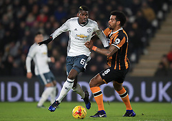 Manchester United's Paul Pogba (left) and Hull City's Tom Huddlestone battle for the ball