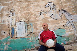 "Rifaat ""Jimmy"" Tourk, a major soccer star in the 1970s and 1980s is seen in Jaffa, Israel, Feb. 1, 2006. Tourk, an Israeli-Arab, born in Jaffa, played on the national team. Fans and players would yell at Tourk, ""Go play in Lebanon!"" and ""Your place is not here with us!"" Current Israeli football star Abbas Suan, an Israeli-Arab, still faces criticism and racism resulting from the unsettled conflict between the Israelis and Palestinians."