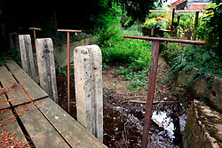 UK ENGLAND HAMPSHIRE ST MARY BOURNE 12AUG06 - Old and disused sluice in the dried-up river bed of the Bourne river in the St Mary Bourne valley in Hampshire...jre/Photo by Jiri Rezac..© Jiri Rezac 2006..Contact: +44 (0) 7050 110 417.Mobile:  +44 (0) 7801 337 683.Office:  +44 (0) 20 8968 9635..Email:   jiri@jirirezac.com.Web:    www.jirirezac.com..© All images Jiri Rezac 2006 - All rights reserved.
