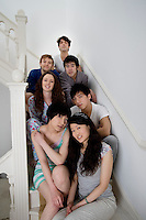 Group portrait of friends sitting in stairway