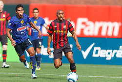 July 16, 2011; San Francisco, CA, USA;  Manchester City defender Gael Clichy (22) dribbles the ball past Club America defender Carlos Valenzuela (6) during the first half at AT&T Park. Manchester City defeated Club America 2-0.
