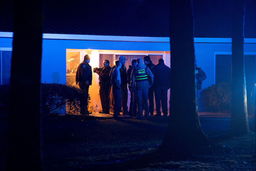 Law enforcement official mill about in front of a house on Ridge Road in unincorporated Paulding County, Ga., where a triple murder/suicide took place on Jan. 6, 2015. A Paulding County Sheriff's Office Corporal was among those killed. (AP Photo/Kevin Liles)