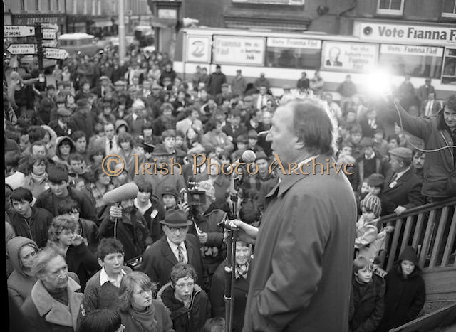Image of Fianna Fáil leader Charles Haughey touring West Cork during his 1982 election campaign...04/02/1982.02/04/82.4th February 1982..A face in the crowd:..Charles Haughey looks over the crowd he addresses.