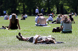 Office workers enjoy the Indian summer in Green Park, London,  Monday, 2nd September 2013. Picture by Stephen Lock / i-Images