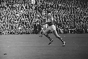 Two Kerry players run towards the ball during the All Ireland Senior Gaelic Football Final Kerry v Down in Croke Park on the 22nd September 1968. Down 2-12 Kerry 1-13.