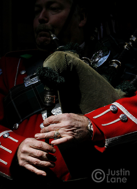 A bagpipe player with the New York City Fire Department Pipes and Drums is seen warming up for the St. Patrick's Day parade in New York on Friday 17 March 2006. The is the 245th year for the annual parade which runs up 5th Avenue and is attended by thousands.