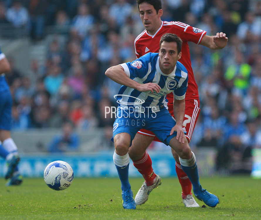 Brighton striker Sam Baldock shields the ball from Cardiff City midfielder Peter Whittingham during the Sky Bet Championship match between Brighton and Hove Albion and Cardiff City at the American Express Community Stadium, Brighton and Hove, England on 3 October 2015. Photo by Bennett Dean.