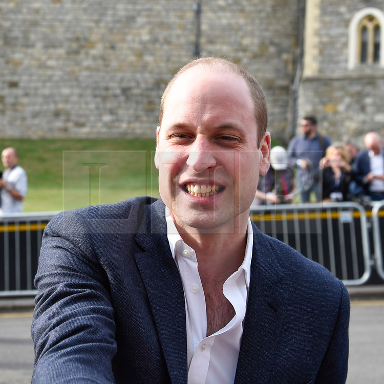 © Licensed to London News Pictures. 18/05/2018. WINDSOR, UK. Prince Harry (not pictured) and Prince William take an impromptu walkabout meeting the public outside Windsor Castle ahead of the wedding between Prince Harry and Meghan Markle on 19 May.  Thousands of people are expected to visit the town for what has been billed as the wedding of the year.  Photo credit: Stephen Chung/LNP