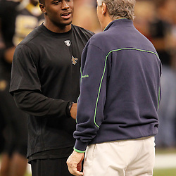 November 21, 2010; New Orleans, LA, USA; New Orleans Saints running back Reggie Bush (25) talks to Seattle Seahawks head coach Pete Carroll during warm ups prior to kickoff of a game at the Louisiana Superdome. Mandatory Credit: Derick E. Hingle