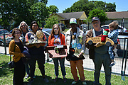 HISD art teachers and staff who won trophies for their art cars, from left: Rebecca Bass with two Heights HS students; Wendy Bejarano of Sam Houston MSTC; HISD's Rickey Polidore; and Julon Pinkston of Frank Black Middle School.