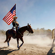 Members of the California Cowgirls head to their positions before performing in the Equine Village Arena during the Alltech FEI World Equestrian Games at the Kentucky Horse Park on Thursday, October 7, 2010. Photo by David Stephenson