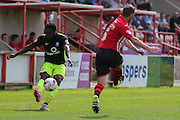 defender Marvin McCoy crosses the ball ahead of defender Jamie McAllister during the Sky Bet League 2 match between Exeter City and York City at St James' Park, Exeter, England on 22 August 2015. Photo by Simon Davies.