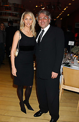 ROBERT TCHENGUIZ and his wife HEATHER at a Burns Night supper in aid of Clic Sargent & Children's Hospital Association Scotland hosted by Ewan McGregor, Sharleen Spieri and Lady Helen Taylor at St.Martin's Lane Hotel, 45 St Martin's Lane, London on 25th January 2006.<br />