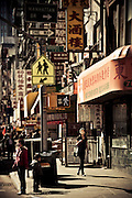 Passer-by on East Brodaway Street in Chinatown, Manhattan, New York, 2010.