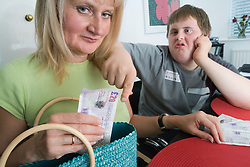 Care home worker taking money off boy with Down's Syndrome,