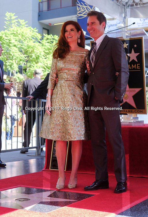 Actors Eric McCormack, right, at a ceremony honoring Debra Messing with a star on the Hollywood Walk of Fame on Friday, Oct. 5, 2017, in Los Angeles.(Photo by Ringo Chiu)<br /> <br /> Usage Notes: This content is intended for editorial use only. For other uses, additional clearances may be required.