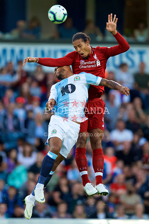 BLACKBURN, ENGLAND - Thursday, July 19, 2018: Liverpool's Virgil van Dijk and Blackburn Rovers' Joe Nuttall during a preseason friendly match between Blackburn Rovers FC and Liverpool FC at Ewood Park. (Pic by David Rawcliffe/Propaganda)
