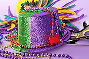 Mardi Gras still life with masks, hat and beads and copy space