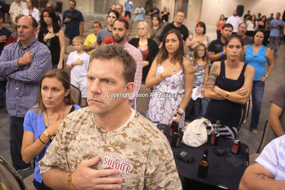 The crowd observes the National Anthem during Battle for a Fallen Soldier Saturday September 14, 2013 at the Wilmington Convention Center. The fights were part of a day that honored Sgt. T.J. Butler IV a local U.S. Army N.C. National Guardsman who was killed in Afghanistan. (Jason A. Frizzelle)
