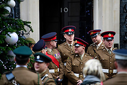 © Licensed to London News Pictures. 14/12/2016. London, UK. Members of British Army pose for a photograph outside 10 Downing Street in London after meeting with British prime minister Theresa May at a reception for a Military awards. Photo credit: Ben Cawthra/LNP