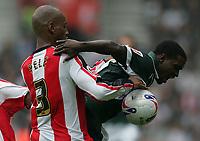 Photo: Lee Earle.<br /> Southampton v Plymouth Argyle. Coca Cola Championship. 16/09/2006. Southampton's Pele (L) battles with Sylvan Ebanks-Blake.