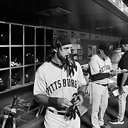 Sean Rodriguez, Pittsburgh Pirates, in the dugout preparing to bat during the New York Mets Vs Pittsburgh Pirates MLB regular season baseball game at Citi Field, Queens, New York. USA. 15th August 2015. Photo Tim Clayton