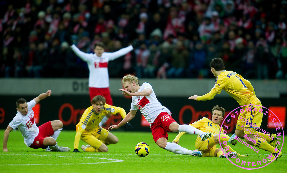 (C) Daniel Lukasik of Poland fights for the ball with (R) Ruslan Rotan of Ukraine during the 2014 World Cup Qualifying Group H soccer match between Poland and Ukraine at National Stadium in Warsaw on March 22, 2013...Poland, Warsaw, March 22, 2013...Picture also available in RAW (NEF) or TIFF format on special request...For editorial use only. Any commercial or promotional use requires permission...Photo by © Adam Nurkiewicz / Mediasport