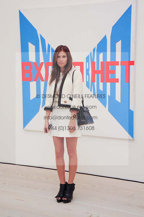 DASHA ZHUKOVA at the BRIC art sale preview (Brazil, Russia, India & China, the acronym BRIC here refers to the burgeoning contemporary art practices within these four countries.) organised by Phillips de Pury & Company at The Saatchi Gallery, London on 17th April 2010.