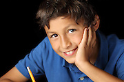 Portrait of smiling young school boy with chiaroscuro lighting - shallow depth of field
