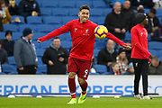 Liverpool striker Roberto Firmino (9) warm up during the Premier League match between Brighton and Hove Albion and Liverpool at the American Express Community Stadium, Brighton and Hove, England on 12 January 2019.