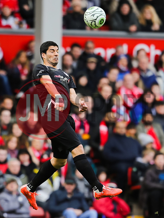 Luis Suarez wins a header - Photo mandatory by-line: Dougie Allward/JMP - Mobile: 07966 386802 - 29/03/2015 - SPORT - Football - Liverpool - Anfield Stadium - Gerrard's Squad v Carragher's Squad - Liverpool FC All stars Game