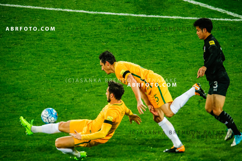 MELBOURNE, AUSTRALIA - SEPTEMBER 5 : Mark Milligan of the Australia Socceroos and Mathew Leckie of the Australia Socceroos try to regain the ball during the Stage 3 Group World Cup Football Qualifiers between Australia Vs Thailand at the Melbourne Rectangular Stadium, Melbourne, Australia 5 September 2017.