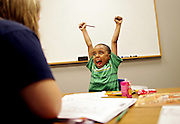 "Jahmir Mojica, 5, reacts after correctly writing the letter ""G"" during a reading and writing tutoring session with Lauren Olson (left) at the Northern Illinois University Literacy Clinic in DeKalb, Ill., on Wednesday July 14, 2010."