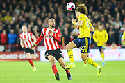 Arsenal defender David Luiz (23) heads the ball as Sheffield United forward David McGoldrick (17) attempts to close him down during the Premier League match between Sheffield United and Arsenal at Bramall Lane, Sheffield, England on 21 October 2019.