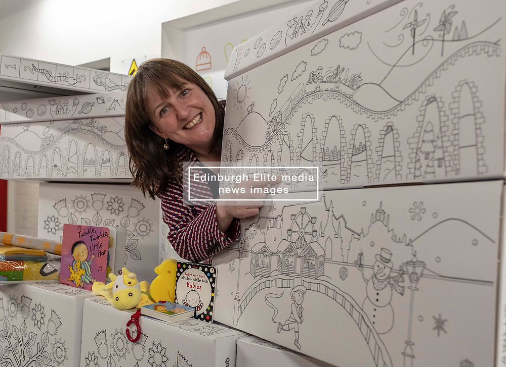 Pictured: <br /><br />Children's Minister Maree Todd visited the APS distribution centre in Edinburgh where the baby boxes are printed, filled and distributed, to meet the young people behind the new baby box design.  The winning design was created by young people from Macduff, Auchterarder, Barrhead, Kilmacolm and Edinburgh as a result of a nationwide Young Scot competition celebrating the Year of Young People.<br /> <br /> Ms Todd presented an award to the winning design team and unveiled the redesigned baby box.<br /> <br /><br />Ger Harley | EEm 27 March 2019