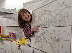 Pictured: <br /><br />Children&rsquo;s Minister Maree Todd visited the APS distribution centre in Edinburgh where the baby boxes are printed, filled and distributed, to meet the young people behind the new baby box design.  The winning design was created by young people from Macduff, Auchterarder, Barrhead, Kilmacolm and Edinburgh as a result of a nationwide Young Scot competition celebrating the Year of Young People.<br /> <br /> Ms Todd presented an award to the winning design team and unveiled the redesigned baby box.<br /> <br /><br />Ger Harley | EEm 27 March 2019