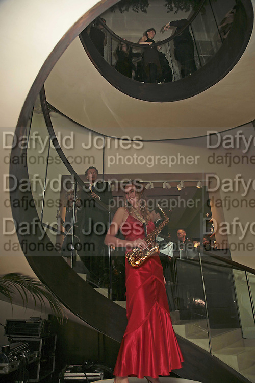 Heather Hoyle playing saxophone, THE CHRISTMAS PARTY CELEBRATING THE 225TH ANNIVERSARY OF ASPREY. 167 NEW BOND ST. LONDON W1. 7 DECEMBER 2006. ONE TIME USE ONLY - DO NOT ARCHIVE  © Copyright Photograph by Dafydd Jones 248 CLAPHAM PARK RD. LONDON SW90PZ.  Tel 020 7733 0108 www.dafjones.com